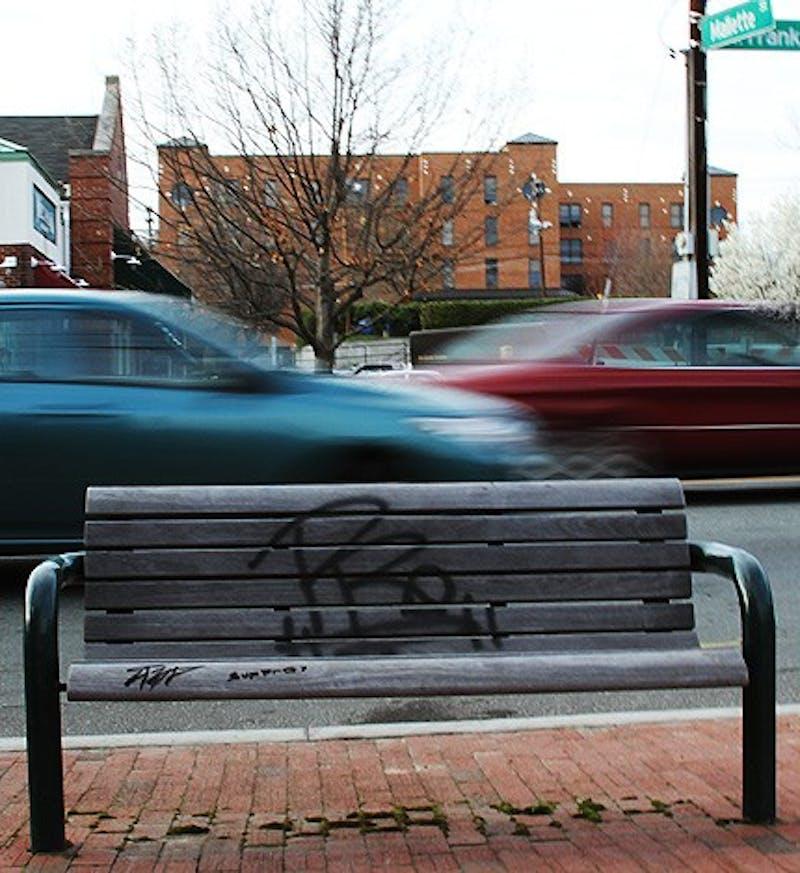 Graffiti on a bench near Chipotle restaurant.