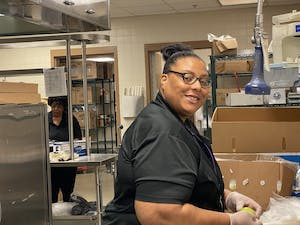 Donetta Evans, a child nutrition worker, preps a school lunch for a Chapel Hill-Carrboro student. Photo courtesy of Christine Cotton.