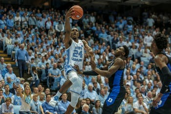 UNC senior guard Kenny Williams (24) attemtps a layup during the home game against Duke on Saturday, March 9 2019 at the Smith Center. The Tar Heels defeated the Blue Devils 70-79 on their senior night, finishing as ACC regular season champions.