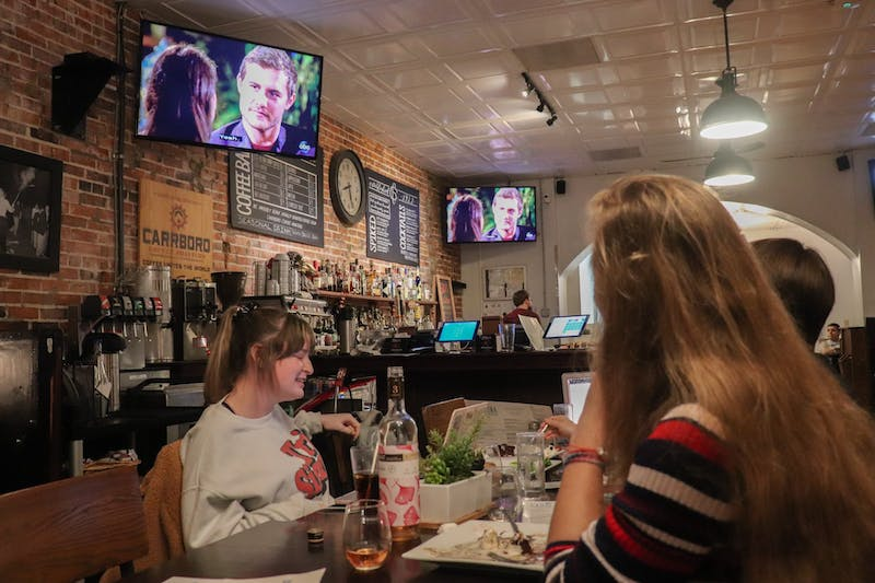 Juniors Claire Amon, a biology and global studies major; Hannah Gahagan, a public policy major; Emily Wesson, a biology major; and Melissa DePierro, a classical archaeology and global studies major gather at Carolina Coffee Shop to watch the latest episode of The Bachelor on Monday, Feb. 10, 2020. The coffee shop hosted a viewing event open to the public.