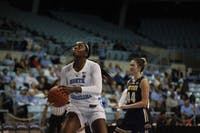 Sophomore center Janelle Bailey (44) makes for a basket during Friday's game against Kent State on Nov. 9, 2018 at Carmichael Arena. UNC won 73-60.