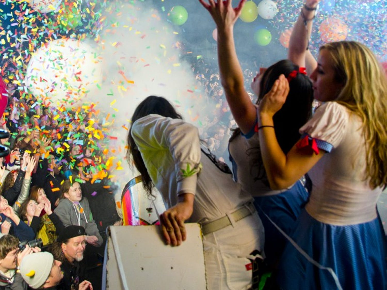 A member of the Flaming Lip's production crew aims a confetti cannon above the crowd at Moogfest 2011.