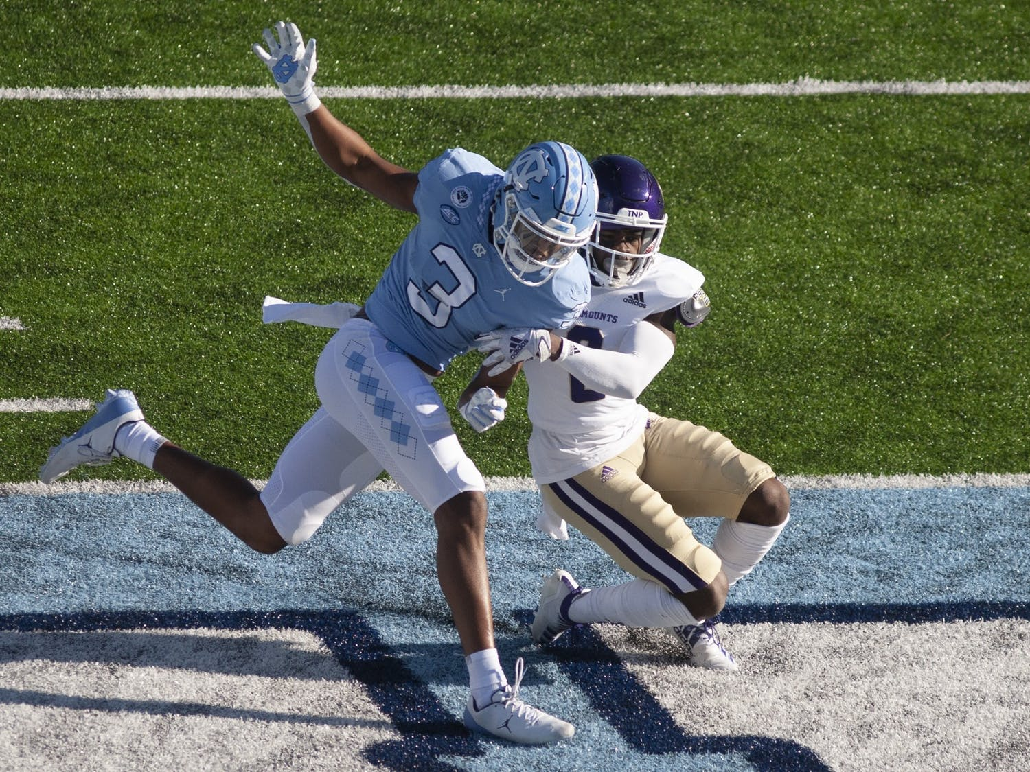 Western Carolina's redshirt sophomore center back  Aaron Gethers (2) tackles UNC's  junior wide receiver Antoine Green (3) in the end zone. UNC defeated WCU 49-9.