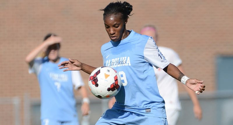 UNC midfielder Crystal Dunn (19) controls the ball.