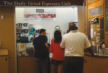 Senior Biology major, Emily Price, serves customers of The Daily Grind Espresso Cafe. The Daily Grind will likely be closed and replaced with the ownership of the UNC Student Stores transitioning to Barnes & Noble on July 1.