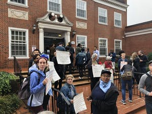 Anti-Silent Sam demonstrators gather outside the Orange County Courthouse on Nov. 5, when the cases of 20 anti-Silent Sam demonstrators were continued until December.