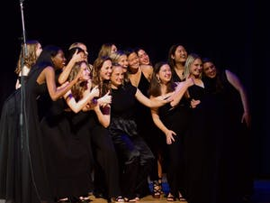 """Members of the UNC a capella group, """"The Loreleis"""" pose for a photo from a previous in-person performance. Photo courtesy of the Loreleis."""