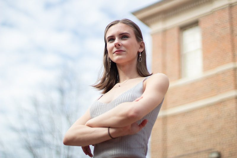 Caitlin Davis, a first year psychology major, poses in front of the Undergraduate Library on Monday, Feb. 17, 2020. Davis founded UNC-CH Students Against Sex Trafficking to address the complexities of sex trafficking in the state, educate students on warning signs and support local recovery resources.