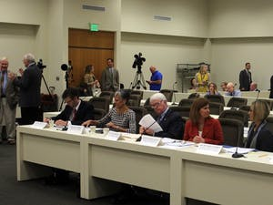 Interim Board of Governors chairperson Lou Bissette (center) answered legislators' questions about the board's transparency.