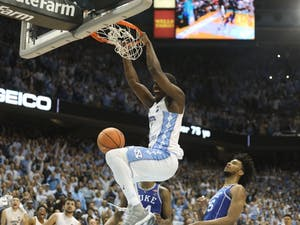Forward Theo Pinson (1) dunks in the final seconds of UNC's 82-78 win over Duke on Thursday night in the Smith Center.