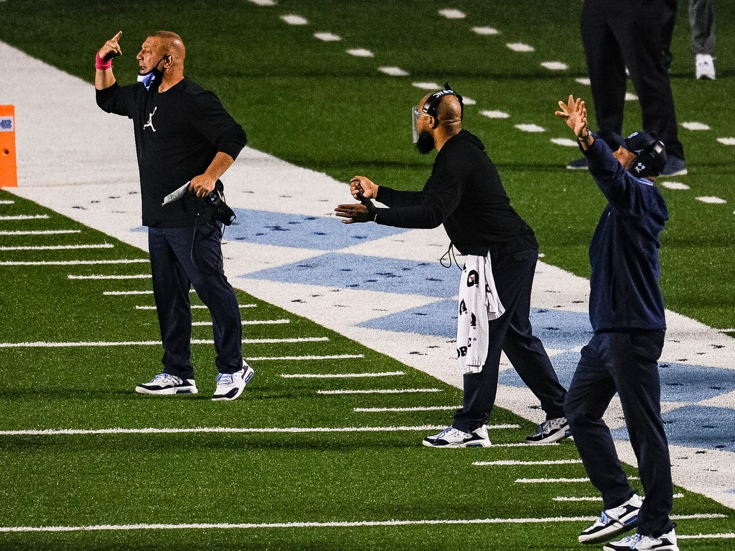 UNC offensive coordinator and quarterbacks coach Phil Longo yells instructions alongside other coaches during a game against Notre Dame in Kenan Memorial Stadium on Friday, Nov. 27, 2020. Notre Dame beat UNC 32-17.