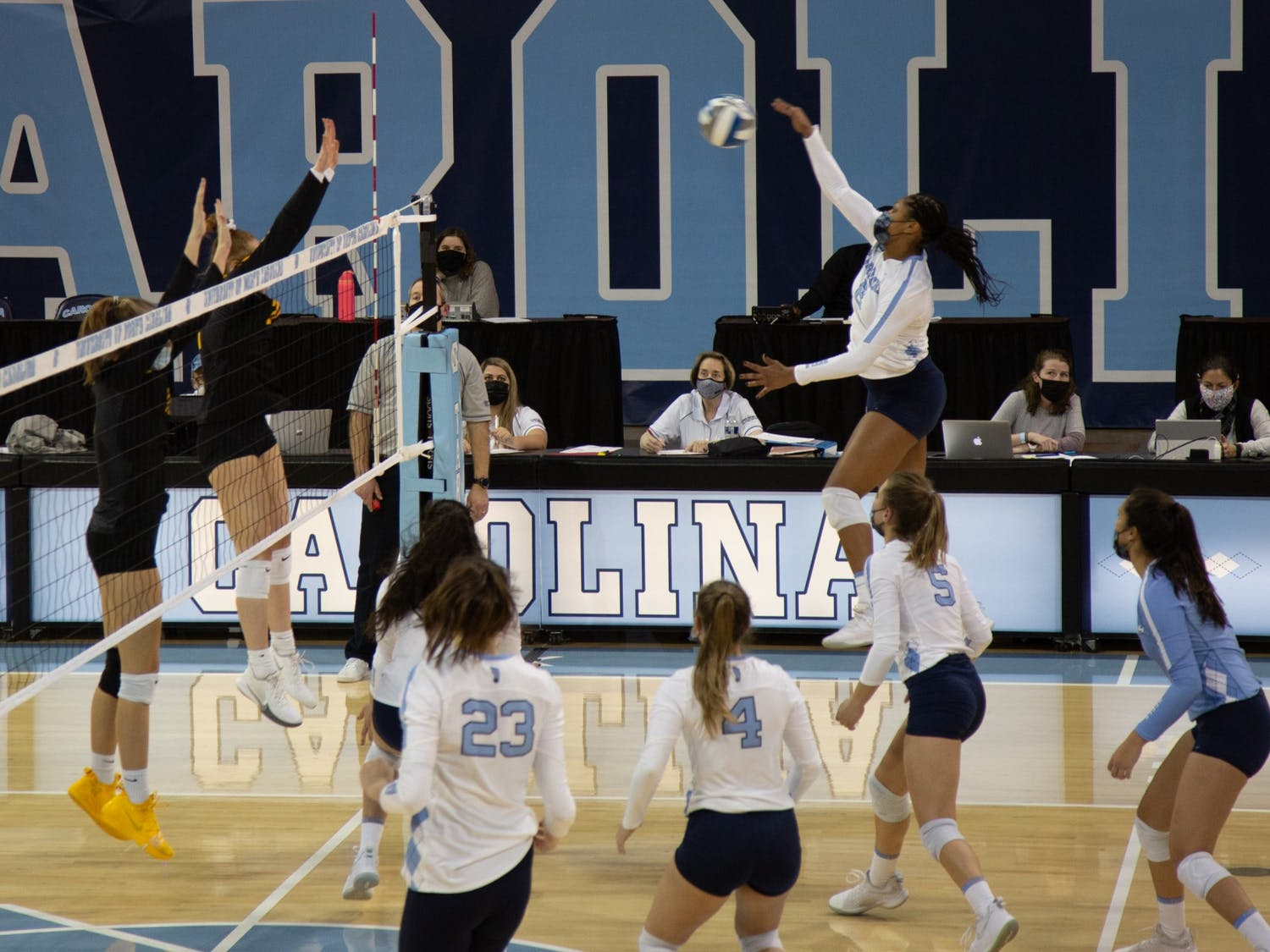 Sophomore middle blocker Skyy Howard (8) prepares to send the ball to the Appalachian State University volleyball team in a game on Thursday, Feb. 18, 2021 in Carmichael Arena. The Tar Heels beat the Mountaineers 3-0.