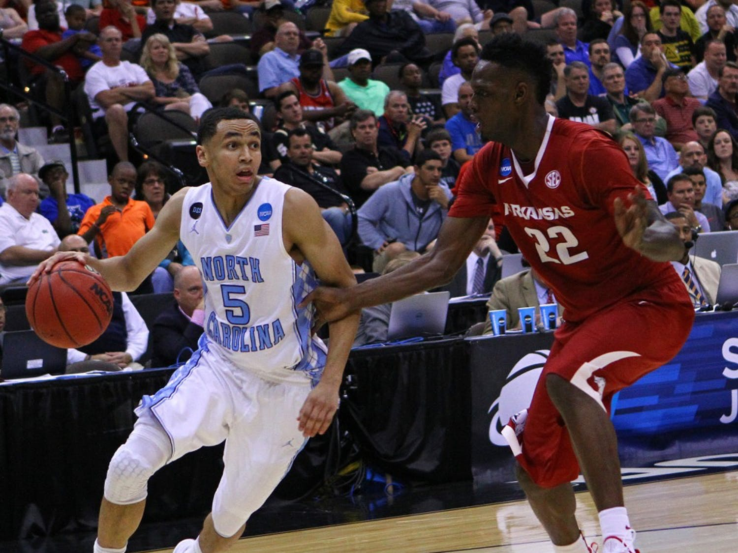 UNC guard Marcus Paige (5) drives to the basket against Arkansas player Jacorey Williams (22).The Tar Heels defeated the Arkansas Razorbacks, 87-78, on Saturday in Jacksonville, Fla.