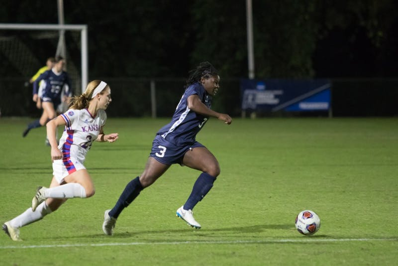 Redshirt Junior forward Ru Mucherera (3) chases the ball down during Women's Soccer's 4-1 victory against Kansas in the second round of the NCAA Women's Soccer Tournament on Friday, Nov. 16 at Wake Med Soccer Park in Cary, North Carolina.