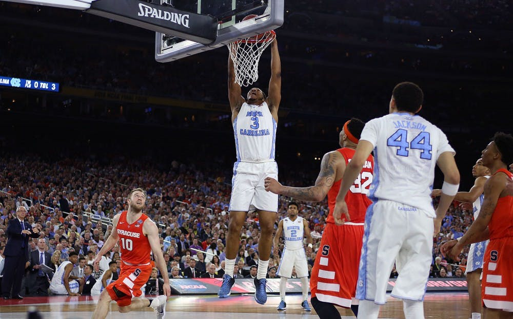 <p>Forward Kennedy Meeks (3) goes up for a dunk.&nbsp;</p>