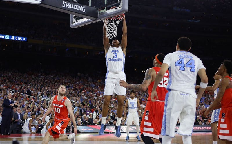 Forward Kennedy Meeks (3) goes up for a dunk.