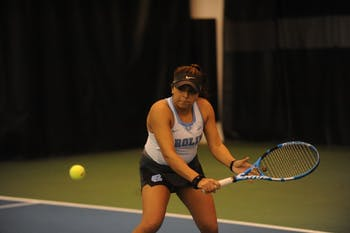 First-year Sophia Patel returns the ball during a singles match against App State on Tuesday, Feb. 19, 2019. UNC won the match against App State 7-0.