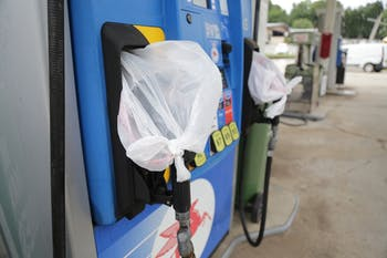 Gas pumps are covered with plastic bags at Run In Jim's gas station on Martin Luther King Jr. Boulevard. This is a common sight at many gas stations in Chapel Hill.