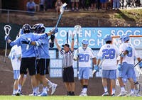 Johns Hopkins' players celebrate a goal during their 13-5 victory over UNC on Saturday, February 25, 2017.