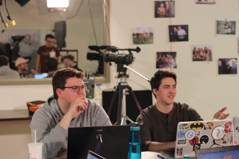 """Senior and former DTH photographer Nick Bafia and sophomore Zach Eanes discuss the UNC Student Television upcoming film """"Fix,"""" which will be submitted to the 2020 Academy Awards, during a workshop session on Jan. 8. 2019."""
