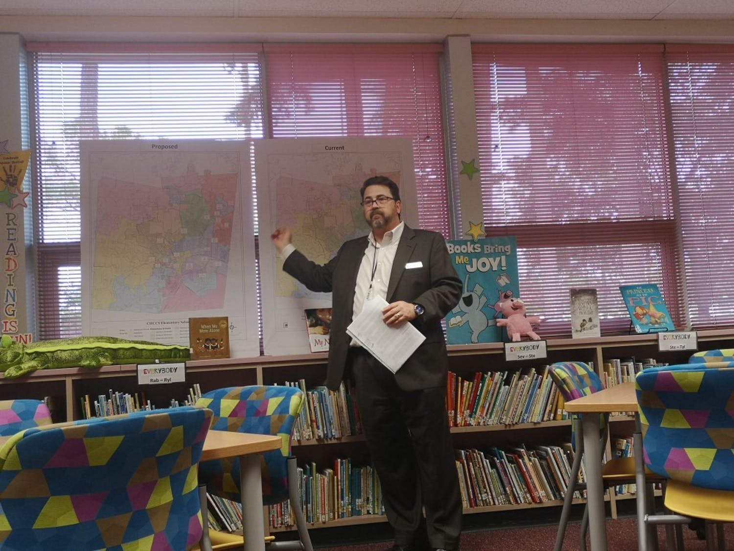 Patrick Abele, assistant superintendent of CHCCS, talks about the proposed and current assignment zones of Glenwood Elementary during the family input session on Monday, Oct. 21, 2019.