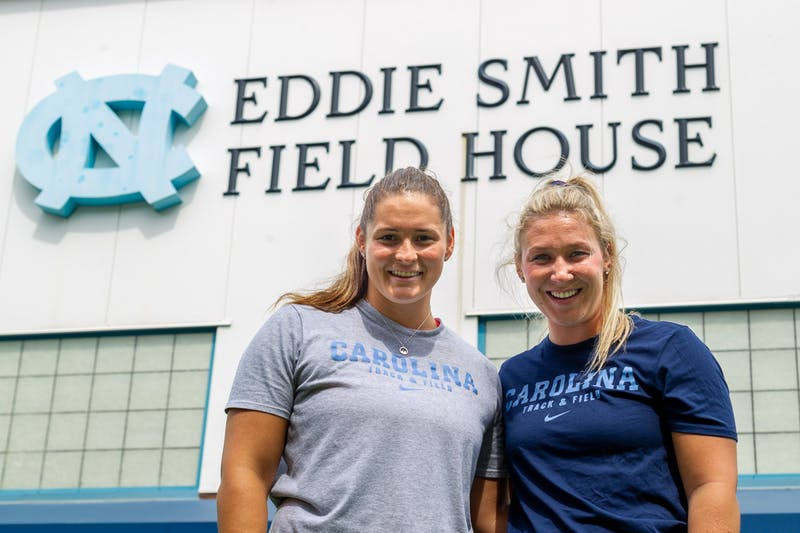UNC senior thrower Jill Shippee (left) and UNC senior javelin thrower Madison Wiltrout (right) pose for a portrait on Aug. 18, 2020. Shippee and Wiltrout are in the same practice pod, which means they work and train together on a regular basis since returning to campus.