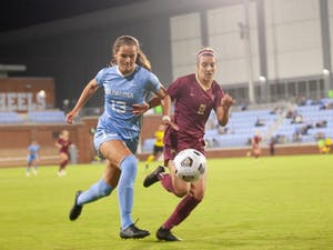 UNC junior forward Isabel Cox fights for the ball against Florida State on Oct. 21. UNC tied with Florida State 2-2.