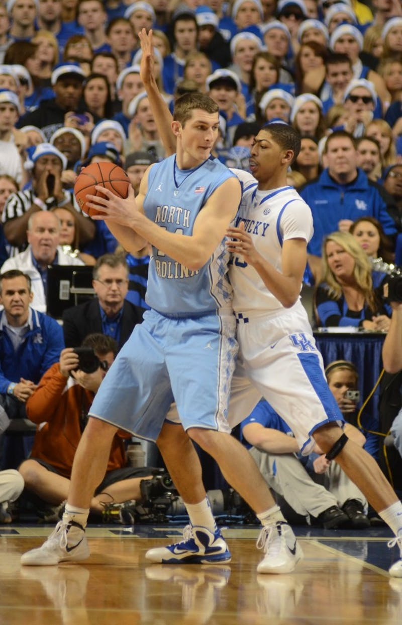 UNC forward Tyler Zeller fights Kentucky defender Anthony Davis for position in UNC's 72-73 loss to Kentucky.