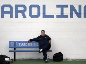 Coach Sam Paul looks on during No. 7 UNC Men's Tennis team's victory over No.5 Oklahoma 4-3 Sunday afternoon.