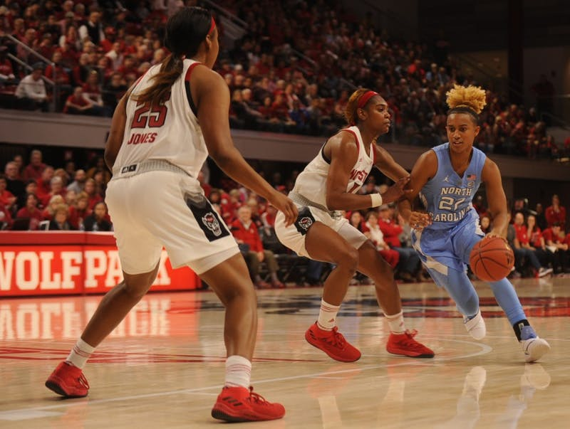 Redshirt senior guard Paris Kea (22) runs down the court during the game against NC State on Sunday, Feb 3, 2019 at Reynolds Coliseum. The UNC women's basketball team beat NC State 64 - 51.