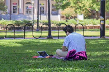 A student studies on the quad on Monday, Oct. 5, 2020.