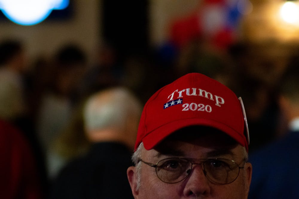 A member of the crowd at Lieutenant Governor Dan Forest's election night party wears a Trump 2020 hat on Tuesday, Nov. 3, 2020.