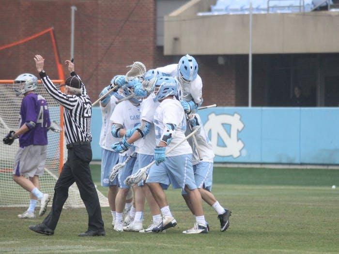 The North Carolina men's lacrosse team celebrates a goal against Furman on Feb. 10 in Kenan Stadium.