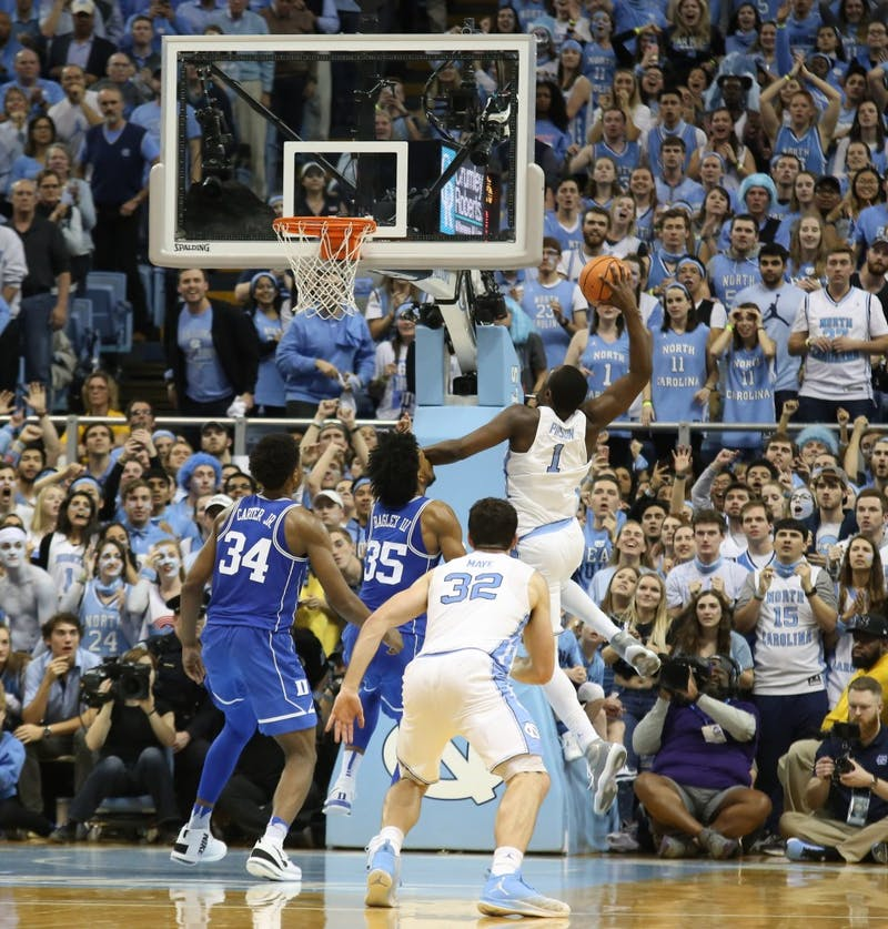 Forward Theo Pinson (1) rears back for an eventually missed dunk against Duke on Thursday night in the Smith Center.