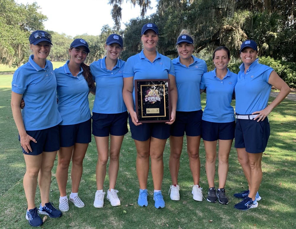 The UNC women's golf team poses around Krista Junkkari's second-place trophy after the Cougar Classic in Charleston, SC, on Sept. 14. Photo Courtesy of UNC Athletic Communications.
