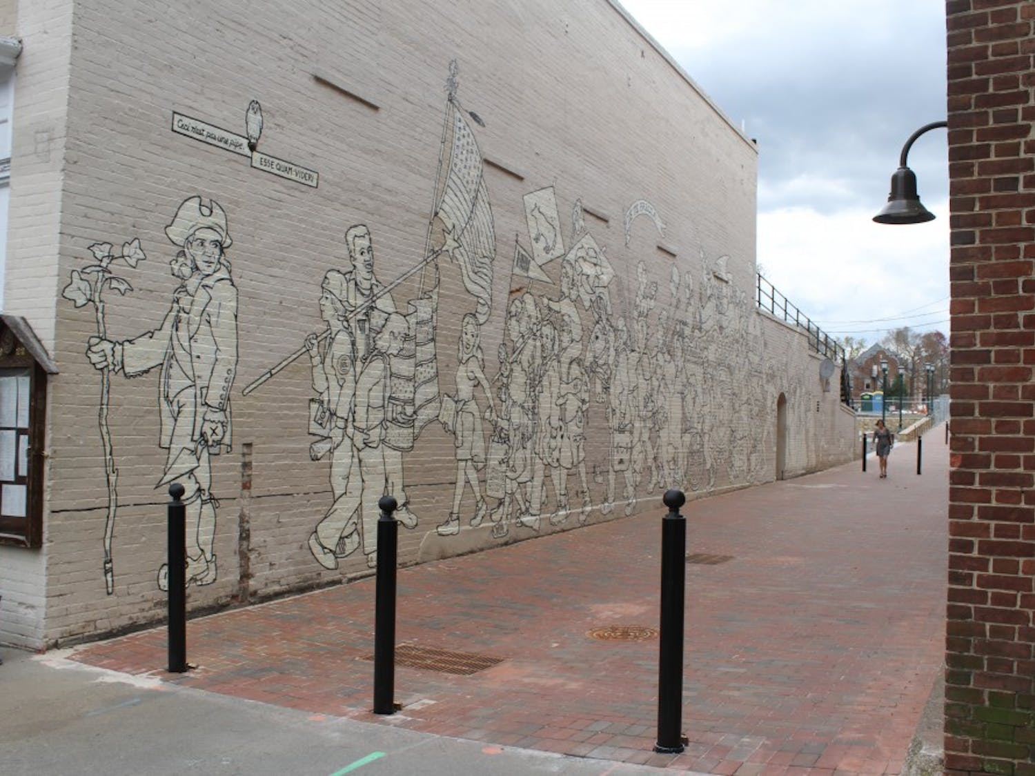 """Porthole Alley contains the """"Parade of Humanity"""" mural, painted in 1997 by Chapel Hill native Michael Brown."""