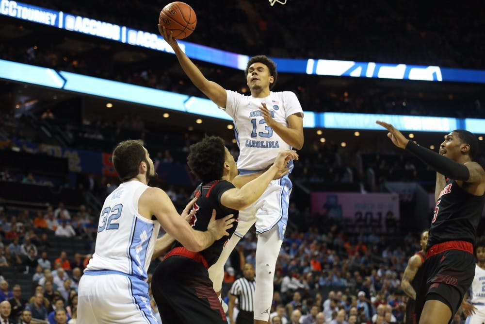 <p>Graduate guard Cameron Johnson attempts a layup in the first half against Louisville in the ACC Tournament quarterfinals at the Spectrum Center in Charlotte.</p>