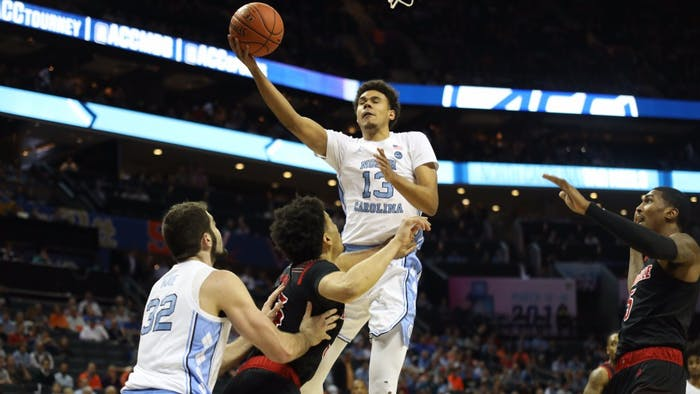Graduate guard Cameron Johnson attempts a layup in the first half against Louisville in the ACC Tournament quarterfinals at the Spectrum Center in Charlotte.