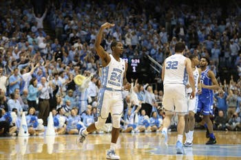 Guard Kenny Williams (24) celebrates a 3-pointer against Duke on Thursday night in the Smith Center.