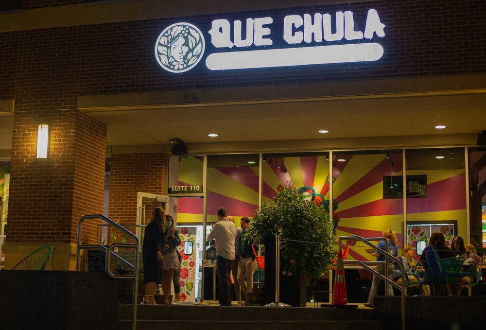 Patrons frequent Que Chula on Franklin Street during a busier time of the night during the week on April 20, 2021.