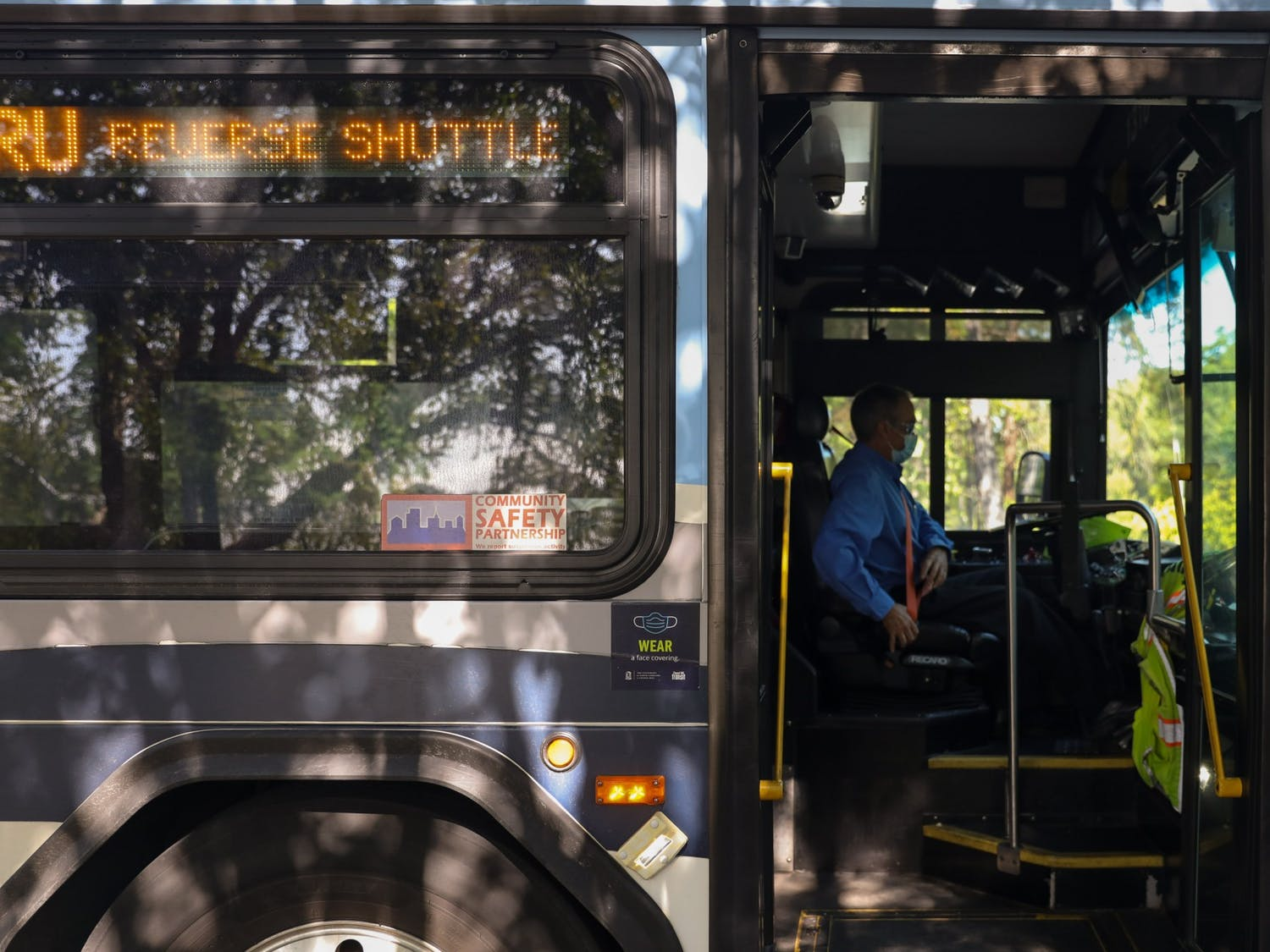 A Chapel Hill Transit bus driver buckles their seat belt on Sept. 15, 2021. Chapel Hill Transit is looking to install temporary changes in order to increase the reliability of the bus system in the wake of a staffing shortage.
