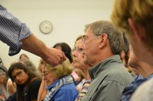 A Chapel Hill resident speaks at Thursday's forum on Silent Sam.