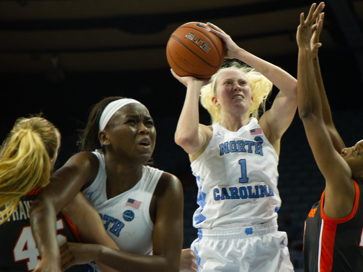 UNC senior guard Taylor Koenen (1) attempts a shot while Syracuse defends during a game in Carmichael Arena on Thursday, Feb. 13, 2020. The Orange beat the Tar Heels 74-56.