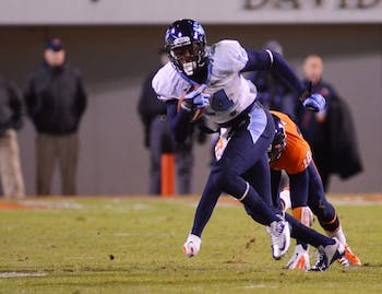 Quinshad Davis breaks a tackle in the first half vs. UVA.
