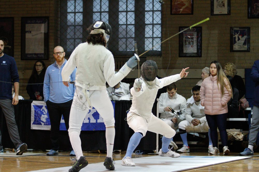 Sophomore foil Anders Hartmark lunges for opponent in a bout against MIT University at the Card Gymnasium on Saturday, Feb. 8, 2020. UNC won this round 6-3 and beat MIT overall 16-11.