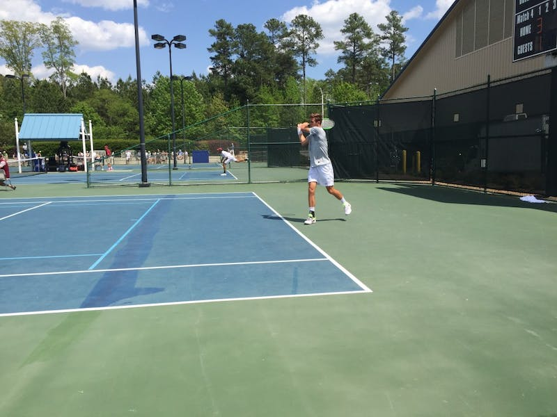 First-year Benjamin Sigouin competes in the ACC Tournament semifinals against Florida State on April 28 at Cary Tennis Park.