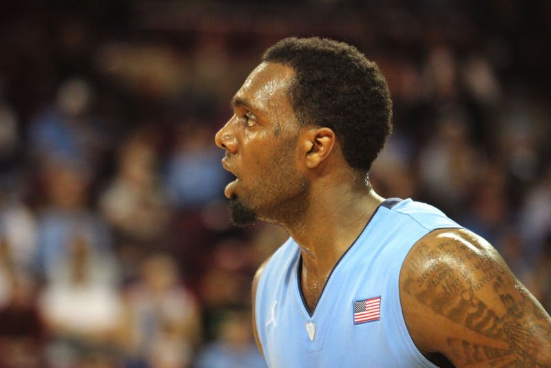P.J. Hairston looks on during the first half.