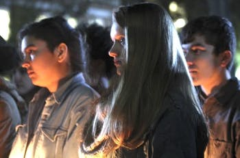 Students gathered on the steps of Wilson Library to attend a vigil honoring the lost and threatened lives in the transgender community on Transgender Day of Remembrance in 2015.