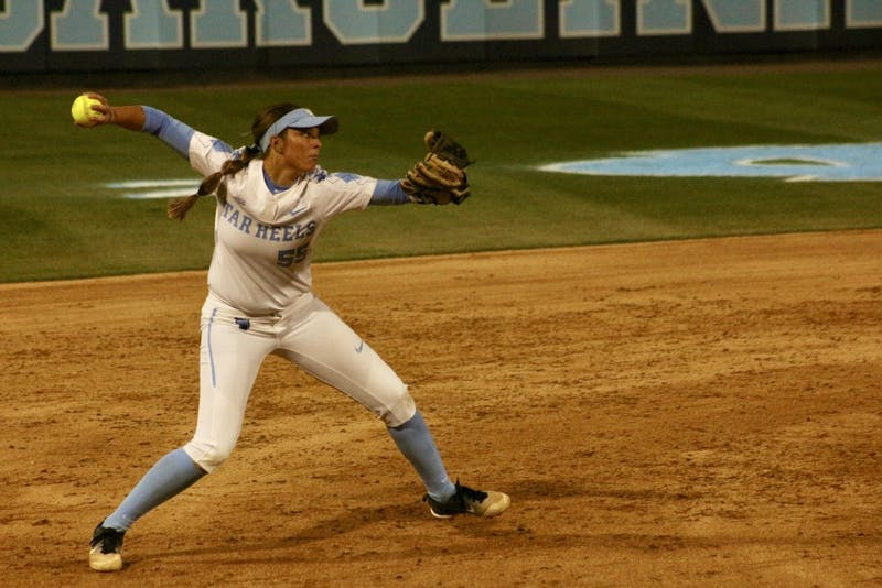 First-year Megan Dray (55) throws to first base for an out against N.C. State on April 16 in Anderson Stadium.