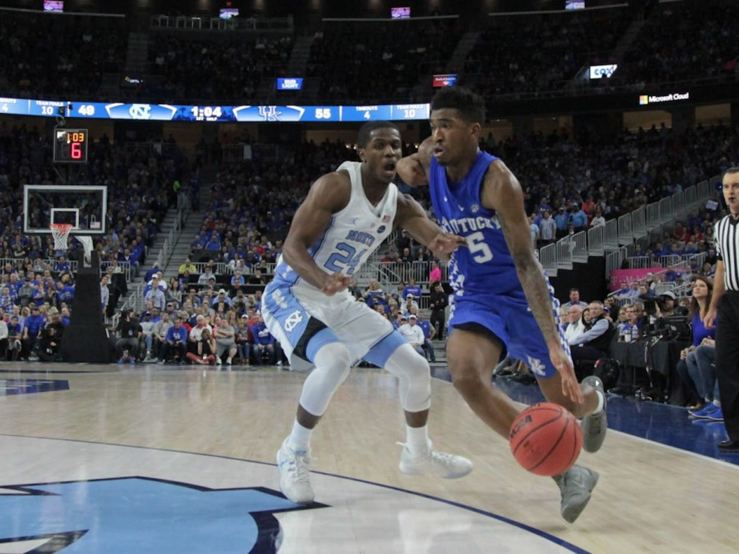 UNC guard Kenny Williams (24) defends Kentucky freshman guard Malik Monk (5) as he drives to the basket at the CBS Sports Classic on Saturday.